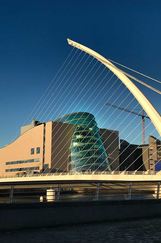 Dublin Skyline featuring the convention centre and the Samuel Becket bridge under a dusky sky reminiscent of pantone Colour of the year 2020